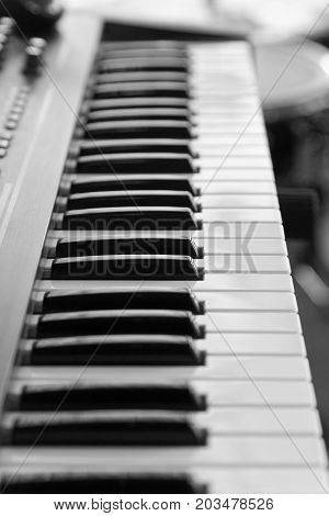 Keyboard Of Music Electronic Synthesizer, Piano On Blurred Backg