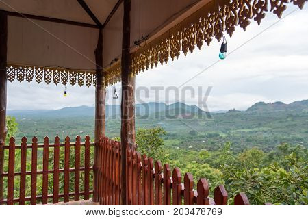 The wood balcony with wood fretting and nature and mountain background, One of the most important places in the district of Li it is also a viewpoint of the city where you can see the sunrise in the morning mist.