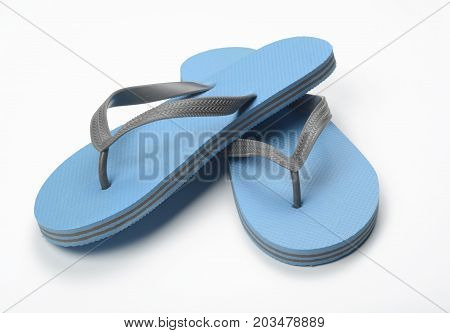Blue thongs on white background, blue object