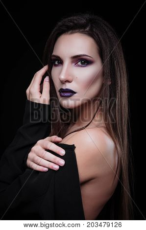 Studio fashion shot: closeup portrait of a gorgeous young woman
