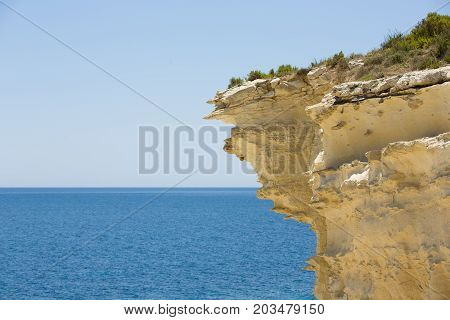Malta, barbed rock formations over the blue sea
