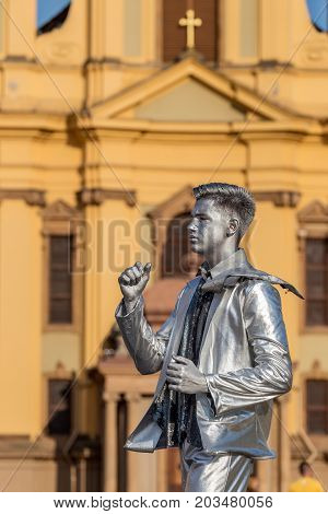 TIMISOARA ROMANIA - SEPTEMBER 8 2017: Living statue of a man silver dressed and present on the street inside the CheckART Carnival organized by the City Hall Timisoara. Union Square.