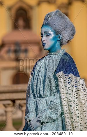 TIMISOARA ROMANIA - SEPTEMBER 8 2017: Living statue of a woman dressed with winter elements and present on the street inside the CheckART Carnival organized by the City Hall Timisoara. Union Square.