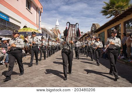 June 17 2017 Pujili Ecuador: performing military band marching on the street at the Corpus Christi events