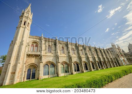Facade of Hieronymites Monastery or Mosteiro dos Jeronimos famous Lisbon landmark in Belem district. The Monastery dos Jeronimos celebrates the return of Portuguese navigator Vasco da Gama.