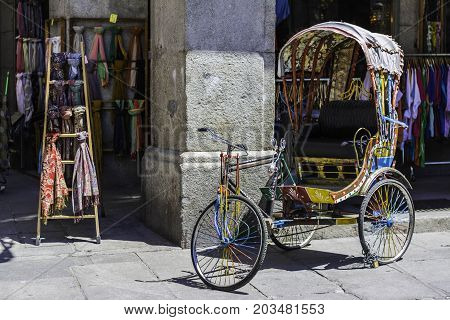 Cycle rickshaw. It is widely used in major cities around the world