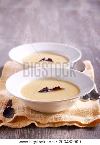 Cauliflower and courgette spicy soup in plate selective focus
