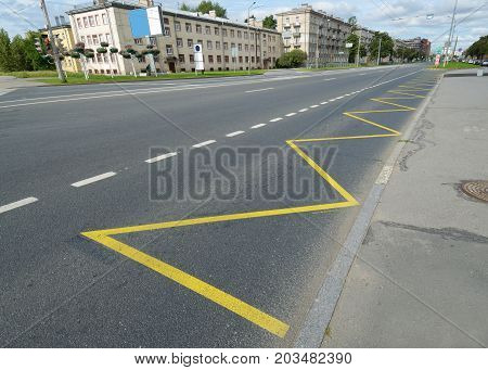 Markings on the roads of the city.Stop for buses.
