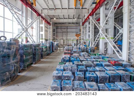 warehouse storage machines molds packed in polyethylene and hoisting crane