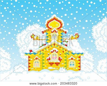 Colorfully decorated small wooden tower covered with snow on Christmas