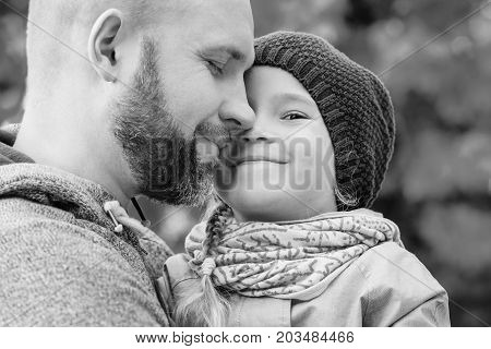 Happy father hugging little daughter in the autumn ( black and white )