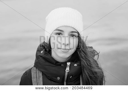 Portrait of kid girl on sea background outdoors in spring time ( black and white )