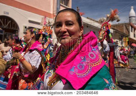 June 17 2017 Pujili Ecuador: indigenous kichwa woman in colourful traditional clothing at the Corpus Christi parade