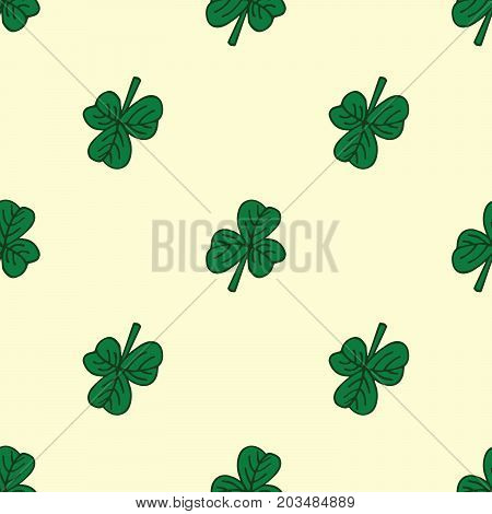 Green clover pattern on beidge. St. Patrick day.