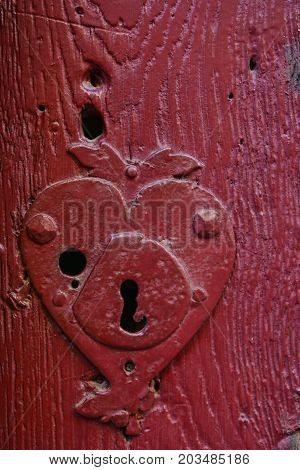 Vintage keyhole in an old red door in Europe