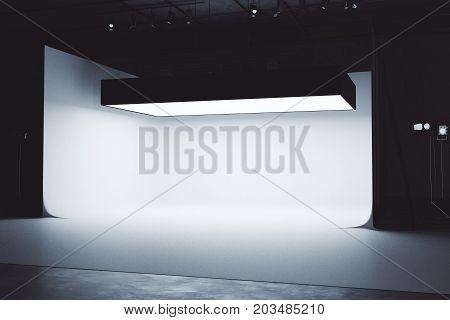 Bright photo studio interior with professional lightint equipment. 3D Rendering