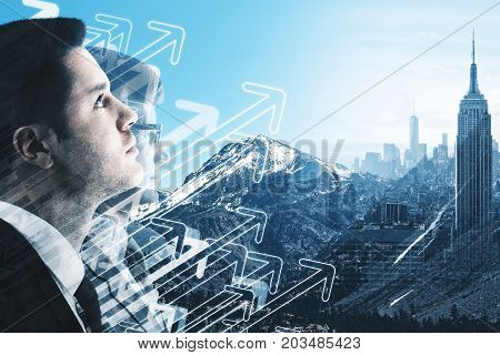 Side view of handsome young businessman on creative city landscape background with drawn upward arrows. Leadership socncept. Double exposure
