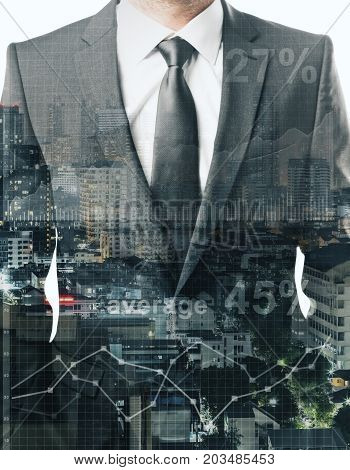 Businessman on abstract city background with forex chart. Financial growth concept. Double exposure