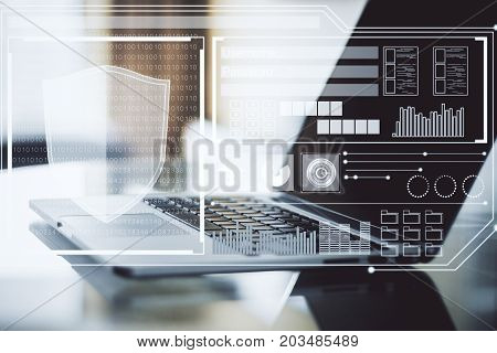 Side view and close up of modern workplace with laptop and antivirus interface. Technology concept. Double exposure