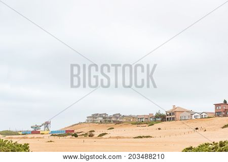 HENTIES BAY NAMIBIA - JUNE 29 2017: Houses on a dune and a waterpark in Henties Bay a holiday town on the Skeleton Coast of Namibia