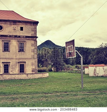 Ronov Hill On Background With Lock, Basketball Basket And Stone Wall In Czech Village Stvolinky In T