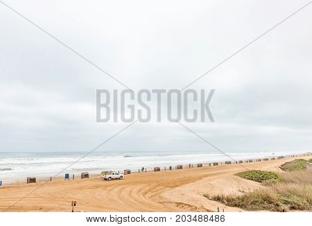 HENTIES BAY NAMIBIA - JUNE 29 2017: A parking area at a beach in Henties Bay a holiday town on the Skeleton Coast of Namibia