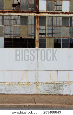 Direct view of an abandoned factory, vertical aspect, horizontal aspect