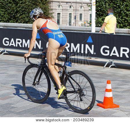 STOCKHOLM - AUG 26 2017: Rear side view of female triathlete cyclist Anastasia Abrosimova in the Women's ITU World Triathlon series event August 26 2017 in Stockholm Sweden