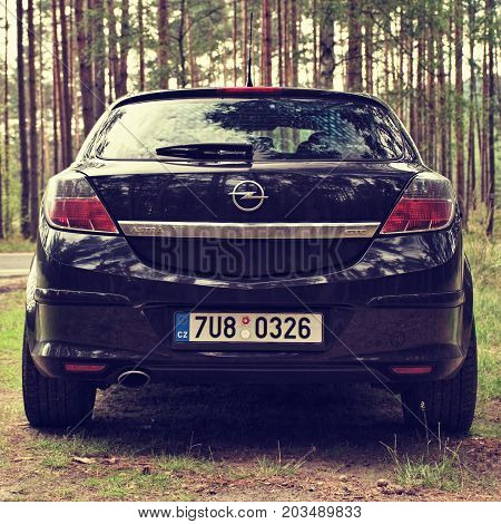 Stare Splavy, Czech Republic - August 19, 2017: Black Car Opel Astra H Stand By  Asphalt Road Betwee