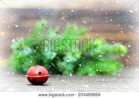 Christmas card with jingle bell and Christmas tree branches