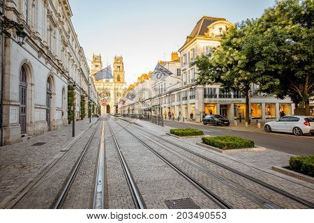 ORLEANS, FRANCE - August 01, 2017: View on the central avenue with famous cathedral during the sunset in Orleans city in central France