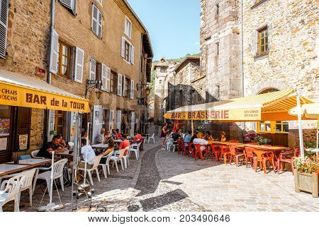 BLESLE, FRANCE - August 01, 2017: Street view with people sitting at the restaurants in Blesle village in Auvergne region, France