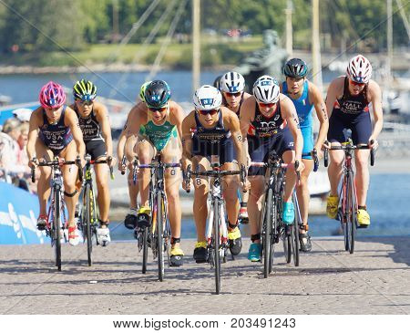 STOCKHOLM - AUG 26 2017: Climbing group of female triathlete cyclists in the Women's ITU World Triathlon series event August 26 2017 in Stockholm Sweden