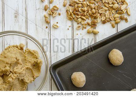 Peanut Butter Cookie Dough Balls On Baking Sheet