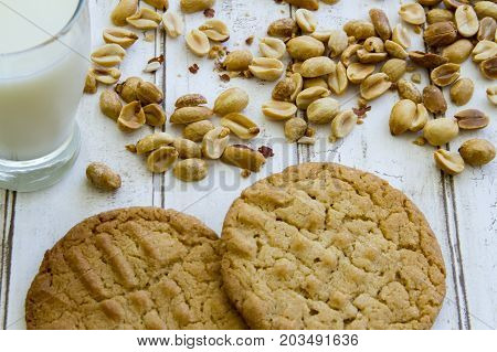 Fresh Baked Peanut Butter Cookies With Glass Of Milk And Peanuts