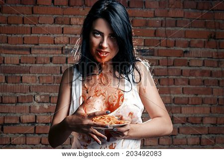 Sexy Seductive Cheeky Girl In White T-shirt And Plate Of Pasta With Ketchup, Lets Out  Ketchup Sauce