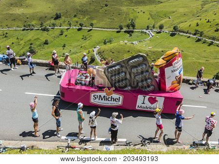 Col de PeyresourdeFrance- July 23 2014: St. Michel Madeleines vehicle passing in the Publicity Caravan on the road to Col de Peyresourde in Pyrenees Mountains during the stage 17 of Le Tour de France 2014.