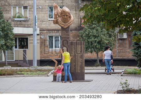Makeevka Ukraine - August 24 2017: Residents of the city near the monument to the soldiers of the Red Army who died in the Second World War in the central square