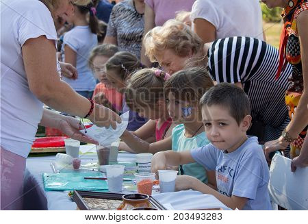 Makeevka Ukraine - August 26 2017: Children on a masterclass in drawing on the celebration of the city's day in the territory of the self-proclaimed Donetskoy republic