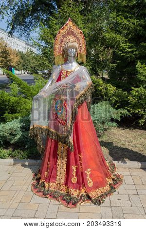Donetsk Ukraine - August 27 2017: Samples of clothes in Russian style with the coat of arms of the USSR in the city center during the celebration of the city's day