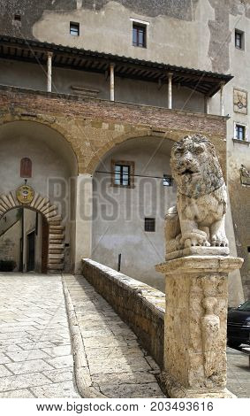 Palazzo Orsini and lion statue in the center of the ancient Italian city Pitigliano, Tuscany, Italy.