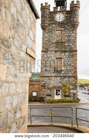 Dufftown - august 2014: dufftown clock tower scotland is a stone tower with a clock at the crossroads in the centre of Dufftown situated in Northeast Scotland. Nearby is a famous and important whiskey distillery