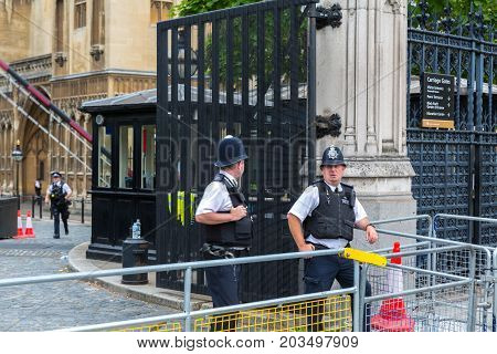 Westminster London - 14th August 2017 - Two armed police officers stand guard outside the Houses of Parliament