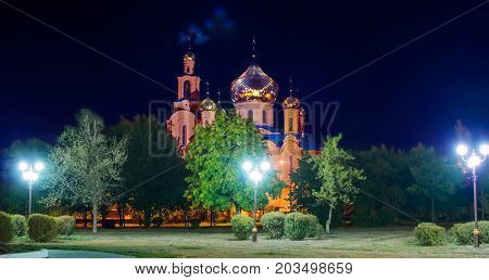 A Panorama of The Church of THE HOLY APOSTLES AND THE GOSPEL JOHN OF BOGHOSLOV in Pokrov city in Ukraire. Panorama of the holy Christian temple in the park at autumn night