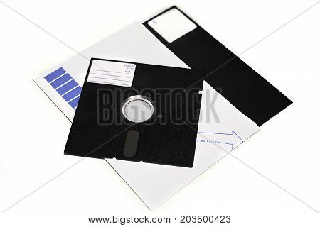 Old 5.25 and 8 inch floppy disks with label isolated on white background