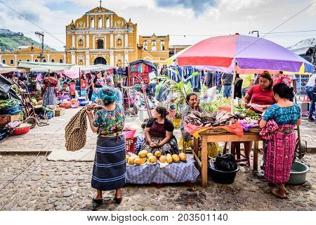 Santa Maria de Jesus Guatemala - August 20 2017: Sunday market stall selling colorful aprons in small indigenous town on slopes of Agua volcano near UNESCO World Heritage Site of Antigua
