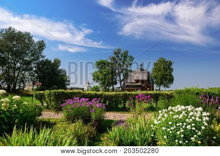 The wooden Church of St. Nicholas in the Kremlin of Suzdal, surrounded by flowers. Suzdal, Vladimir region, Golden Ring, Russia