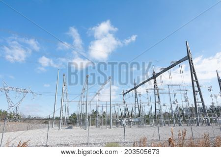 Power from an electrical power plant is transported to a substation. The substation consists of many inductors where the voltage received from the power plant is stepped up to high voltage.