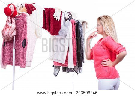 Woman In Home Closet Choosing Clothing, Indecision