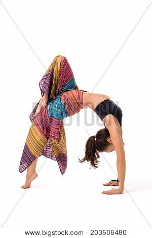 Slim girl striped sarong wraped over her body practising yoga routine indoors isolated on white
